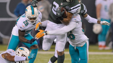 New York Jets running back Matt Forte (22) is tackled by the Miami Dolphins during the fourth quarter of an NFL football game, Saturday, Dec. 17, 2016, in East Rutherford, N.J. (AP Photo/Bill Kostroun)