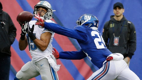 New York Giants cornerback Eli Apple (24) deflects a pass to Detroit Lions' Golden Tate (15) during the first half of an NFL football game Sunday, Dec. 18, 2016, in East Rutherford, N.J. (AP Photo/Seth Wenig)