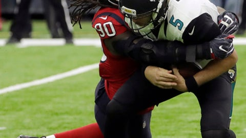 Jacksonville Jaguars quarterback Blake Bortles (5) is hit by Houston Texans defensive back Don Jones (20) during the first half of an NFL football game Sunday, Dec. 18, 2016, in Houston. (AP Photo/David J. Phillip)