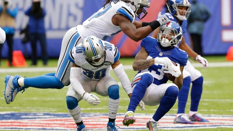 Detroit Lions outside linebacker Josh Bynes (57) and Asa Jackson (30) attempt to tackle New York Giants' Odell Beckham (13) during the first half of an NFL football game Sunday, Dec. 18, 2016, in East Rutherford, N.J. (AP Photo/Seth Wenig)