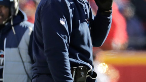 Tennessee Titans head coach Mike Mularkey talks on his headset during the first half of an NFL football game against the Kansas City Chiefs in Kansas City, Mo., Sunday, Dec. 18, 2016. (AP Photo/Charlie Riedel)