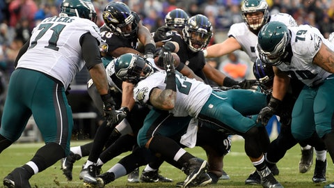 Philadelphia Eagles running back Ryan Mathews (24) rolls into the end zone for a two point conversion during the first half of an NFL football game against the Baltimore Ravens in Baltimore, Sunday, Dec. 18, 2016. (AP Photo/Gail Burton)
