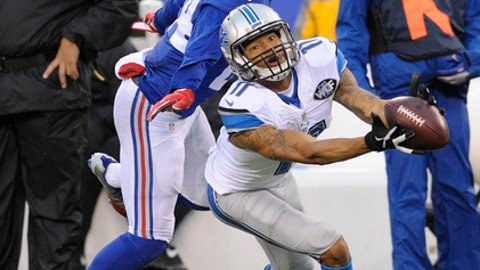 Detroit Lions wide receiver Marvin Jones (11) catches a pass in front of New York Giants' Eli Apple (24) during the second half of an NFL football game Sunday, Dec. 18, 2016, in East Rutherford, N.J. (AP Photo/Bill Kostroun)