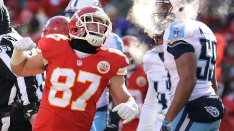 Kansas City Chiefs tight end Travis Kelce (87) reacts in front of Tennessee Titans linebacker Wesley Woodyard (59) after a run during the first half of an NFL football game against the Tennessee Titans in Kansas City, Mo., Sunday, Dec. 18, 2016. (AP Photo/Charlie Riedel)