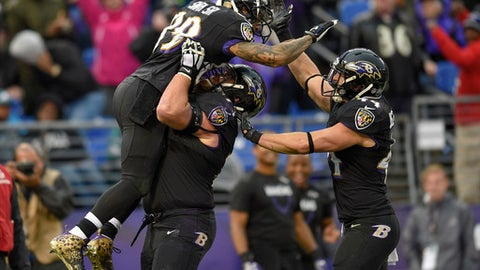 Baltimore Ravens wide receiver Steve Smith (89) celebrates his touchdown with guard Marshal Yanda (73) and fullback Kyle Juszczyk (44) during the first half of an NFL football game against the Philadelphia Eagles in Baltimore, Sunday, Dec. 18, 2016. (AP Photo/Nick Wass)