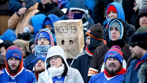 Spectators look on during the second half of an NFL football game between the Buffalo Bills and the Cleveland Browns, Sunday, Dec. 18, 2016, in Orchard Park, N.Y. (AP Photo/Jeffrey T. Barnes)