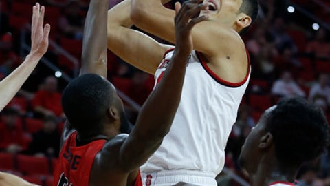 North Carolina State's Omer Yurtseven, top, shoots as Fairfield's Amadou Sidibe (21) defends during the first half of an NCAA college basketball game in Raleigh, N.C., Sunday, Dec. 18, 2016. (Ethan Hyman/The News & Observer via AP)