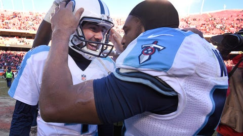 Tennessee Titans kicker Ryan Succop, left, is congratulated by linebacker Wesley Woodyard (59) after making the winning field goal during the second half of an NFL football game against the Kansas City Chiefs in Kansas City, Mo., Sunday, Dec. 18, 2016. (AP Photo/Ed Zurga)