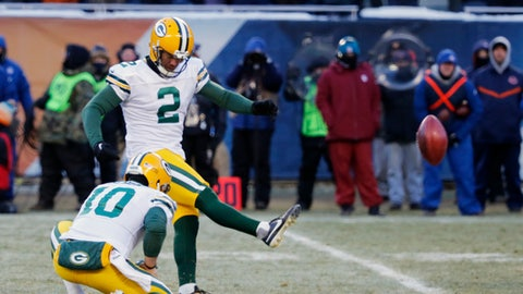 Green Bay Packers kicker Mason Crosby (2) kicks the game-winning field goal against the Chicago Bears during the second half of an NFL football game, Sunday, Dec. 18, 2016, in Chicago. The Packers won 30-27.(AP Photo/Charles Rex Arbogast)