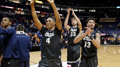 Gonzaga's Jordan Mathews (4), Killian Tillie (33) and Josh Perkins (13) applaud their fans as they leave the court after defeating Tennessee 86-76 in an NCAA college basketball game Sunday, Dec. 18, 2016, in Nashville, Tenn. (AP Photo/Mark Humphrey)
