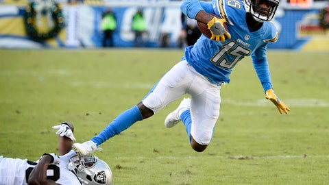 San Diego Chargers wide receiver Dontrelle Inman (15) gets away from Oakland Raiders strong safety T.J. Carrie (38) during the second half of an NFL football game Sunday, Dec. 18, 2016, in San Diego. (AP Photo/Denis Poroy)