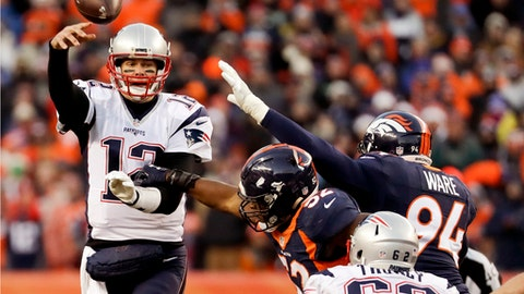 New England Patriots quarterback Tom Brady passes under pressure against the Denver Broncos during the second half of an NFL football game Sunday, Dec. 18, 2016, in Denver. (AP Photo/Jack Dempsey)