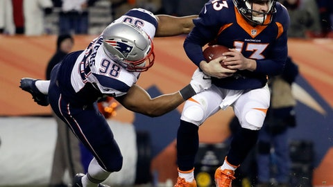 Denver Broncos quarterback Trevor Siemian, right, shakes off New England Patriots defensive end Trey Flowers during the second half of an NFL football game Sunday, Dec. 18, 2016, in Denver. (AP Photo/Jack Dempsey)