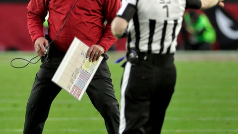 Arizona Cardinals head coach Bruce Arians yells at side judge Scott Novak (1) during the second half of an NFL football game against the New Orleans Saints, Sunday, Dec. 18, 2016, in Glendale, Ariz. (AP Photo/Rick Scuteri)