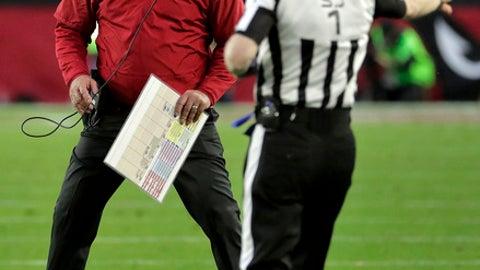 Arizona Cardinals head coach Bruce Arians yells at side judge Scott Novak (1) during the second half of an NFL football game against the New Orleans Saints, Sunday, Dec. 18, 2016, in Glendale, Ariz. (AP Photo/Rick Scuteri)