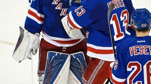 New York Rangers goalie Henrik Lundqvist (30) and New York Rangers center Kevin Hayes (13) celebrates the Rangers 3-2 win over the New Jersey Devils in a shootout of an NHL hockey game in New York, Sunday, Dec. 18, 2016. Hayes scored the winning goal. (AP Photo/Kathy Kmonicek)