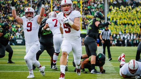 """FILE - In this Nov. 12, 2016, file photo, Stanford running back Christian McCaffrey (5) runs for a touchdown in the first quarter of an NCAA college football game, in Eugene, Ore. McCaffrey is done playing college football. Stanford's star running back announced on Twitter on Monday, Dec. 19, 2016,  that he will not play in the 16th-ranked Cardinal's Sun Bowl game against North Carolina (8-4) on Dec. 30 in El Paso, Texas. """"Very tough decision, but I have decided not to play in the Sun Bowl so I can begin my draft prep immediately,"""" McCaffrey said. (AP Photo/Thomas Boyd, File)"""
