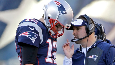 FILE - In this Dec. 4, 2016, file photo, New England Patriots quarterback Tom Brady (12) confers with offensive coordinator Josh McDaniels during the first half of an NFL football game against the Los Angeles Rams, in Foxborough, Mass. Patriots coordinators McDaniels and Matt Patricia have been considered among the best minds in football for a while now. The jobs they're doing this season _ their latest gems came in a 16-3 victory over the Broncos on Sunday _ have only bolstered their standing. (AP Photo/Elise Amendola, File)