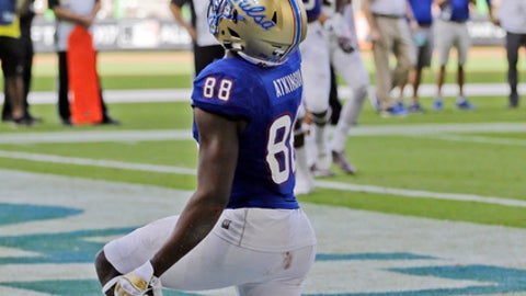Tulsa wide receiver Josh Atkinson (88) celebrates after scoring a touchdown against Central Michigan in the first half of the Miami Beach Bowl NCAA college football game, Monday, Dec. 19, 2016, in Miami. (AP Photo/Alan Diaz)