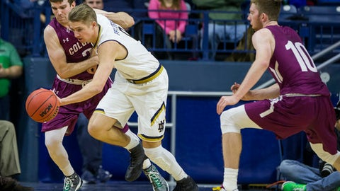 Notre Dame's Rex Pflueger, center, steals the ball between Colgate's Nathan Harries, left, and Will Rayman (10) during the first half of an NCAA college basketball game, Monday, Dec. 19, 2016, in South Bend, Ind. (AP Photo/Robert Franklin)