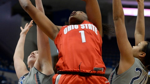 Connecticut's Natalie Butler, left, knocks the ball away from Ohio State's Stephanie Mavunga, center, as Connecticut's Napheesa Collier, right, defends, in the first half of an NCAA college basketball game, Monday, Dec. 19, 2016, in Hartford, Conn. (AP Photo/Jessica Hill)