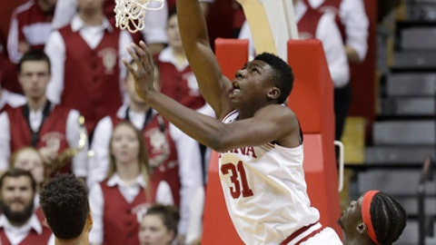 Indiana center Thomas Bryant (31) puts up a shot against Delaware State center Demola Onifade, right, and forward DeVaughn Mallory, left, during the first half of an NCAA college basketball game Monday, Dec. 19, 2016, in Bloomington, Ind. (AP Photo/Darron Cummings)