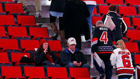 Detroit Red Wings and Carolina Hurricane fans leave their seats following the cancellation of the Red Wings game with the Carolina Hurricanes due to a problem with the ice in the PNC Arena, Monday, Dec. 19, 2016, in Raleigh, N.C. Game will be rescheduled. (AP Photo/Karl B DeBlaker)