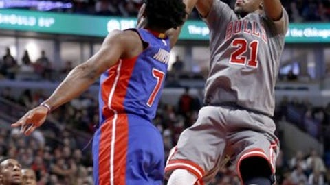 CORRECTS SCORE- Chicago Bulls' Jimmy Butler, right, shoots and scores over Detroit Pistons' Stanley Johnson (7) during the second half of an NBA basketball game, Monday, Dec. 19, 2016, in Chicago. The Bulls won 113-82. (AP Photo/Charles Rex Arbogast)