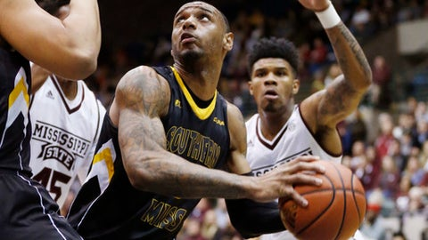 Southern Mississippi forward Raheem Watts (0) looks for a open shot as Mississippi State defenders close in during the first half of an NCAA college basketball game in Jackson, Miss., Monday, Dec. 19, 2016. (AP Photo/Rogelio V. Solis)