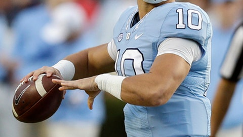 FILE - In this Nov. 19, 2016, file photo, North Carolina quarterback Mitch Trubisky (10) looks to pass against The Citadel during the first half of an NCAA college football game in Chapel Hill, N.C. Trubisky is focusing more on playing Stanford in the Sun Bowl than the NFL decision that awaits. The junior is projected as a possible first-round draft pick if he skips his final season with the Tar Heels. (AP Photo/Gerry Broome, File)