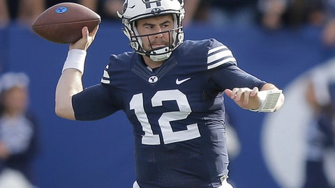 FILE - This Nov. 12, 2016, file photo, shows BYU quarterback Tanner Mangum (12) passing in the first half during an NCAA college football game against Southern Utah, in Provo, Utah. Wyoming meets BYU in the Poinsetta Bowl on Wednesday.  (AP Photo/Rick Bowmer, File)