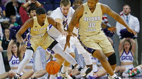 Grand Canyon guard Gerard Martin, center, tries to take the ball from Alcorn State guard A.J. Mosby (2) and forward Marquis Vance (30) during the first half of an NCAA college basketball game Tuesday, Dec. 20, 2016, in Glendale, Ariz. (David Kadlubowski/The Arizona Republic via AP)