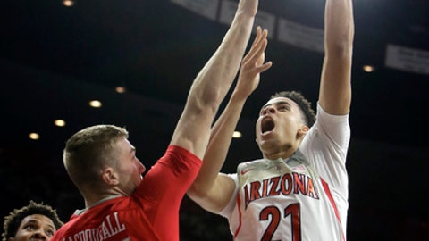 Arizona center Chance Comanche (21) shoots over New Mexico forward Connor MacDougall during the second half of an NCAA college basketball game, Tuesday, Dec. 20, 2016, in Tucson, Ariz. (AP Photo/Rick Scuteri)