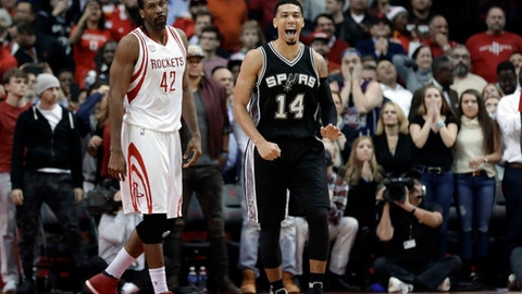 San Antonio Spurs' Danny Green (14) celebrates as Houston Rockets' Nene Hilario (42) walks behind during the closing seconds of an NBA basketball game Tuesday, Dec. 20, 2016, in Houston. The Spurs won 102-100. (AP Photo/David J. Phillip)