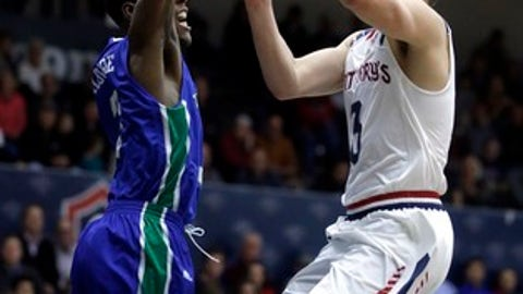 Saint Mary's Emmett Naar, right, shoots past Texas A&M-Corpus Christi's Joseph Kilgore during the first half of an NCAA college basketball game Tuesday, Dec. 20, 2016, in Moraga, Calif. (AP Photo/Ben Margot)