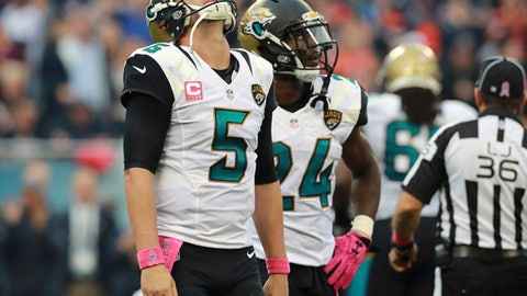 FILE - In this Oct. 16, 2016, file photo, Jacksonville Jaguars quarterback Blake Bortles (5) reacts after fumbling the ball against the Chicago Bears during an NFL football game in Chicago. The Jaguars (2-12) have a chance to reach another low by failing to win a single home game for the first time in the franchise's 22 years. They need to upset AFC South rival Tennessee (8-6) to avoid the miserable mark. (AP Photo/Jeff Haynes, File)