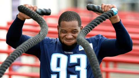 FILE - In this Aug. 4, 2016, file photo, Tennessee Titans outside linebacker Kevin Dodd does a conditioning drill with heavy ropes during NFL football training camp in Nashville, Tenn. Each college football team that reaches the postseason gets additional practices to get ready for that bowl game. Clemson's Dabo Swinney cited former Tigers defensive end Kevin Dodd as a player who benefited from bowl practices. (AP Photo/Mark Zaleski, File)