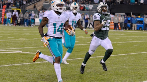FILE - In this Dec. 17, 2016, file photo, Miami Dolphins wide receiver Jarvis Landry (14) runs for a touchdown against the New York Jets during an NFL football game in East Rutherford, N.J. Landry prepares to play Saturday, Dec. 24, against the Buffalo Bills, who are still upset about the illegal block he leveled earlier this year that sidelined their teammate Aaron Williams with a season-ending concussion.(AP Photo/Bill Kostroun, File)