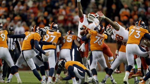 FILE -  In this Sunday, Nov. 27, 2016 file photo, Denver Broncos kicker Brandon McManus (8) misses a 62-yard field goal attempt as Riley Dixon (9) holds during overtime of an NFL football game against the Kansas City Chiefs in Denver. The Denver Broncos have many regrets about their 30-27 overtime loss to Kansas City last month. Going for the gusto isn't among them. (AP Photo/Joe Mahoney, File)