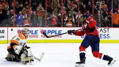 Philadelphia Flyers' Steve Mason, left, blocks a shot by Washington Capitals' Justin Williams during a shootout in an NHL hockey game, Wednesday, Dec. 21, 2016, in Philadelphia. Philadelphia won 3-2. (AP Photo/Matt Slocum)