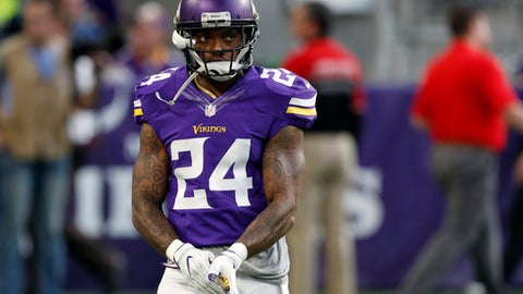 FILE - In this Dec. 18, 2016 file photo, Minnesota Vikings cornerback Captain Munnerlyn warms up before the start of an NFL football game between the Indianapolis Colts and the Minnesota Vikings, in Minneapolis. The fortunes of the Vikings and Green Bay Packers are headed in opposite directions as the division rivals meet on Christmas Eve.  (AP Photo/Charlie Neibergall, File)