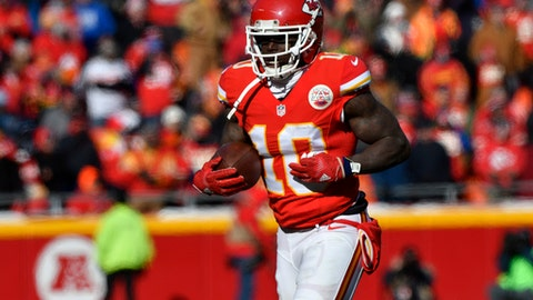 FILE - In this Dec. 18, 2016 file photo, Kansas City Chiefs wide receiver Tyreek Hill (10) holds the ball after he scored a touchdown on a 68-yard rush, during the first half of an NFL football game against the Tennessee Titans in Kansas City, Mo. The Chiefs could have their playoff berth assured before kickoff against the Broncos on Sunday night, Dec. 25  provided the Pittsburgh Steelers knock off the Baltimore Ravens earlier in the day. (AP Photo/Ed Zurga, File)