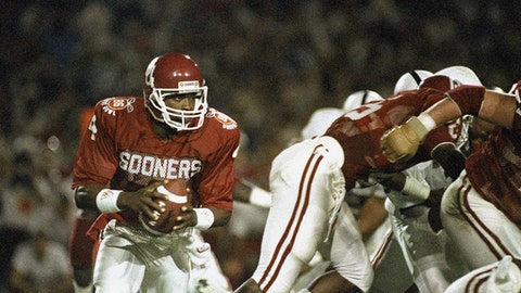 FILE - In this Jan. 1, 1986 file photo, University of Oklahoma quarterback Jamelle Holieway (4) looks for an open man as his team battles Penn State University in the Orange Bowl in Miami. Holieway dazzled the college football world as a true freshman who mastered Oklahoma's dynamic wishbone attack and led the Sooners to the 1985 national championship. Now, Alabama true freshman Jalen Hurts is on the cusp of becoming the first true freshman quarterback since Holieway to win it all.   (AP Photo/Joe Skipper, File)