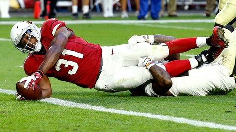 FILE - In this Dec. 18, 2016 file photo, Arizona Cardinals running back David Johnson (31) scores a touchdown as New Orleans Saints cornerback B.W. Webb defends during the second half of an NFL football game, in Glendale, Ariz. The Seattle Seahawks will host the Cardinals on Saturday, Dec. 24. (AP Photo/Ross D. Franklin, File)