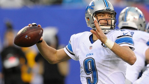 FILE - In this Sunday, Dec. 18, 2016 file photo, Detroit Lions quarterback Matthew Stafford (9) throws a pass during the second half of an NFL football game against the New York Giants in East Rutherford, N.J. The Lions play the Dallas Cowboys on Monday, Dec. 26, 2016. (AP Photo/Bill Kostroun, File)