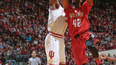 Austin Peay forward Kenny Jones, right, shoots over Indiana center Thomas Bryant during the first half of an NCAA college basketball game in Bloomington, Ind., Thursday, Dec. 22, 2016. (AP Photo/AJ Mast)