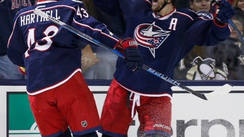 Columbus Blue Jackets' Brandon Dubinsky, right, and Scott Hartnell celebrate their goal against the Pittsburgh Penguins during the second period of an NHL hockey game Thursday, Dec. 22, 2016, in Columbus, Ohio. (AP Photo/Jay LaPrete)