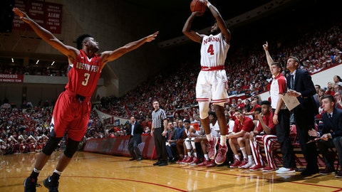 Indiana guard Robert Johnson (4) shoots over Austin Peay forward Chris Porter-Bunton (3) during the second half of an NCAA college basketball game in Bloomington, Ind., Thursday, Dec. 22, 2016. Indiana won 97-62. (AP Photo/AJ Mast)
