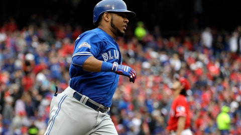 Toronto Blue Jays' Edwin Encarnacion rounds the bases after hitting a solo home run off of Texas Rangers' Yu Darvish in the fifth inning of Game 2 of baseball's American League Division Series, Friday, Oct. 7, 2016, in Arlington, Texas. (AP Photo/David J. Phillip)