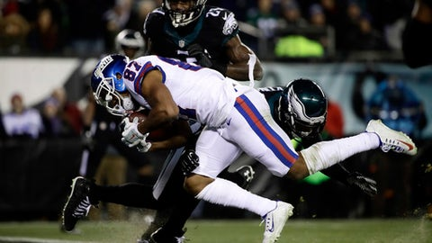 New York Giants' Sterling Shepard (87) scores a touchdown against Philadelphia Eagles' Jaylen Watkins (26) during the first half of an NFL football game, Thursday, Dec. 22, 2016, in Philadelphia. (AP Photo/Matt Rourke)